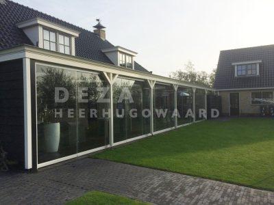 Deza Kozijnen Heerhugowaard - referentie balkonbeglazing - glazen schuifwand onder overkapping Waarland